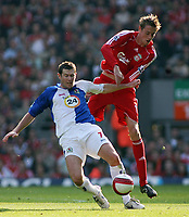 Photo: Paul Thomas.<br /> Liverpool v Blackburn Rovers. The Barclays Premiership. 14/10/2006.<br /> <br /> Brett Emerton (L) of Blackburn wins the ball from Peter Crouch.