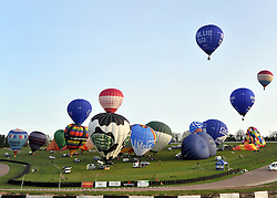 ©London News pictures. 07/04/2011. CANTERBURY: Balloons head off towards the channel. Approximately 50 hot air balloons from across the UK and Europe take advantage of the weather window and take off from Lydden Hill Race Circuit, Wootton, Kent, to fly across the English Channel marking the largest ever group of balloons to attempt the crossing. The participants  have been waiting since October for the event to happen. Picture credit should read Stephen Simpson/LNP