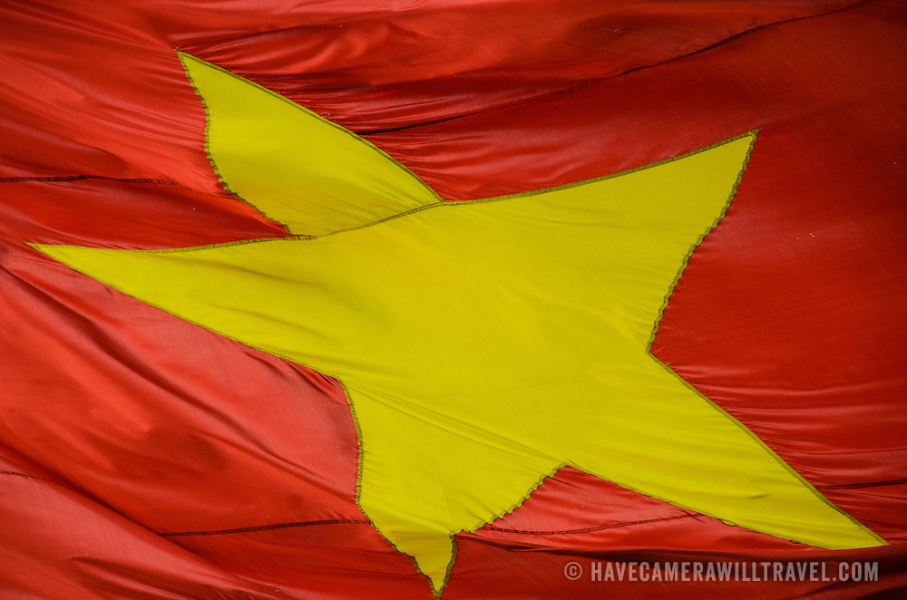 Close-up of the gold star in the a Vietnamese flag flying in the breeze.