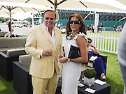 ANDREW NEIL; SUSAN NILSSON, Cartier International Polo. Guards Polo Club. Windsor Great Park. 25 July 2010. -DO NOT ARCHIVE-© Copyright Photograph by Dafydd Jones. 248 Clapham Rd. London SW9 0PZ. Tel 0207 820 0771. www.dafjones.com.