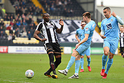 Notts County forward Shola Ameobi (9) and Coventry City's Chris Stokes (3) during the EFL Sky Bet League 2 match between Notts County and Coventry City at Meadow Lane, Nottingham, England on 7 April 2018. Picture by Jon Hobley.