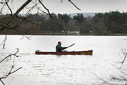 © Licensed to London News Pictures. 21/12/2019. Pulborough, UK. A canoeist paddles across flooded fields after the River Arun burst its banks and flooded local businesses and farm land in Pulborough, West Sussex. River levels remain high after heavy overnight rain in the south where more rain is expected today. Photo credit: Peter Macdiarmid/LNP