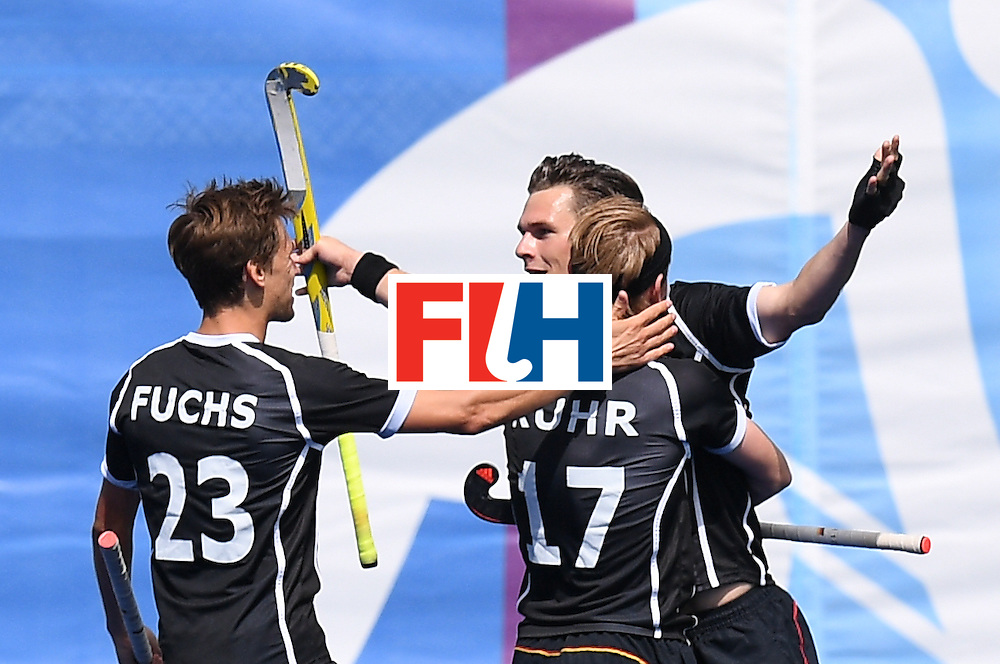 Germany's Christopher Wesley (2R) celebrates scoring a goal during the men's field hockey Argentina vs Germany match of the Rio 2016 Olympics Games at the Olympic Hockey Centre in Rio de Janeiro on August, 11 2016. / AFP / MANAN VATSYAYANA        (Photo credit should read MANAN VATSYAYANA/AFP/Getty Images)
