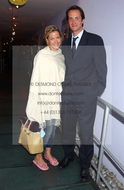 Left to right, the HON.EDWARD TOLLEMACHE and MISS SOPHIE JOHNSTONE at a polo players party hosted by AJM International Publishing and Cartier celebrating the 21st anniversary of the Cartier International Polo held at The Collection, London SW3 on 19th July 2005.<br />