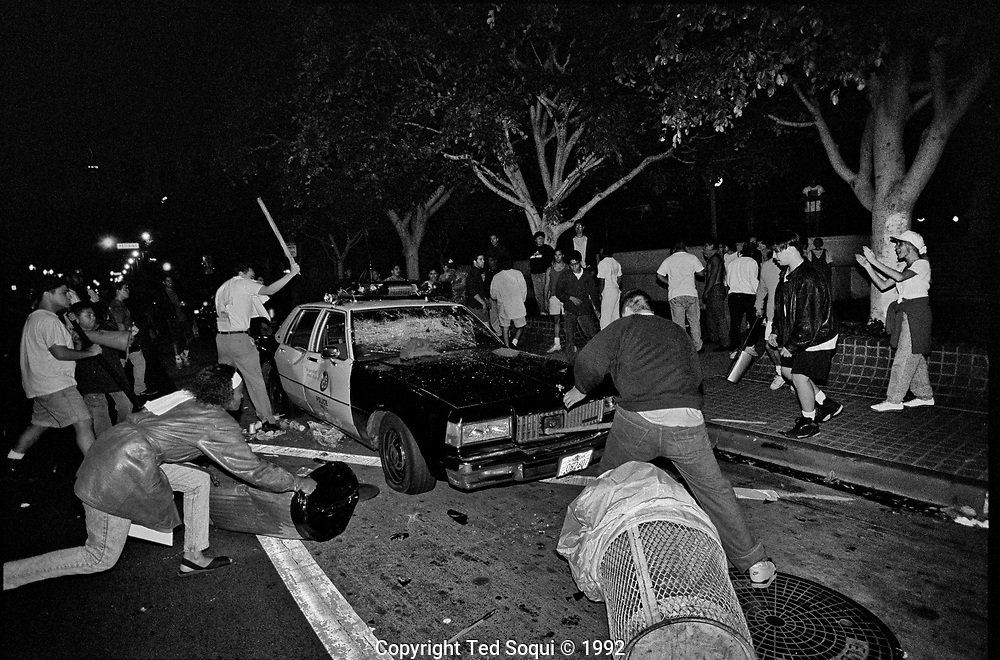 A LAPD cruiser getting destroyed by rioters in downtown Los Angeles. 4/29/1992