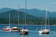 Kayakers and sailboats on Lake Champlain, Charlotte, Vermont