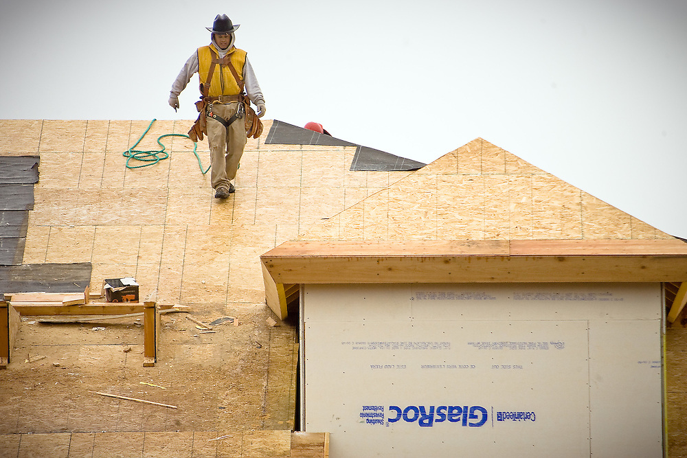 JEROME A. POLLOS/Press..A construction worker walks along one of the roof tops at Riverstone.