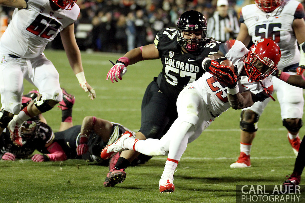 October 26th, 2013:  University of Arizona Wildcats junior running back Ka'Deem Carey (25) falls into the end zone for a touchdown in the fourth quarter of the NCAA football game between the University of Arizona Wildcats and the University of Colorado Buffaloes at Folsom Field in Boulder, Colorado