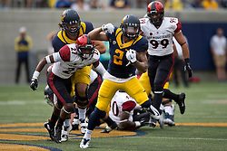BERKELEY, CA - SEPTEMBER 12:  Running back Daniel Lasco #2 of the California Golden Bears rushes past defensive back Kameron Kelly #27 of the San Diego State Aztecs during the third quarter at California Memorial Stadium on September 12, 2015 in Berkeley, California. The California Golden Bears defeated the San Diego State Aztecs 35-7. (Photo by Jason O. Watson/Getty Images) *** Local Caption *** Daniel Lasco; Kameron Kelly