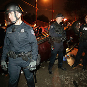 March 31, 2012 - Lexington, Kentucky, USA - Lexington police officers push back a crowd after they overturned a car as University of Kentucky basketball fans celebrate their team's victory over the University of Louisville in Lexington, Ky., on March 31, 2012. The win for Kentucky advances them to the championship game of the NCAA tournament in New Orleans. Fans took to the streets and in burned couches, turned over a car and ending with a handful of arrests. (Credit image: © David Stephenson/ZUMA Press)