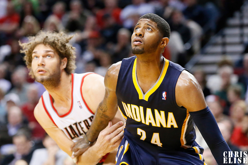 02 December 2013: Indiana Pacers small forward Paul George (24) vies for the rebound with Portland Trail Blazers center Robin Lopez (42) during the Portland Trail Blazers 106-102 victory over the Indiana Pacers at the Moda Center, Portland, Oregon, USA.