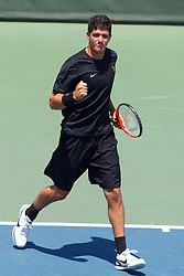 May 24, 2011; Stanford, CA, USA;  Southern California number 2 doubles player Emilio Gomez celebrates after winning a point against the Virginia Cavaliers during the finals of the men's team 2011 NCAA Tennis Championships at the Taube Tennis Center.