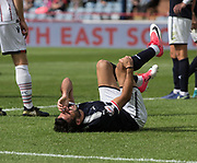 August 5th 2017, Dens Park, Dundee, Scotland; Scottish Premiership; Dundee versus Ross County; Dundee's Sofien Moussa in agony after injury