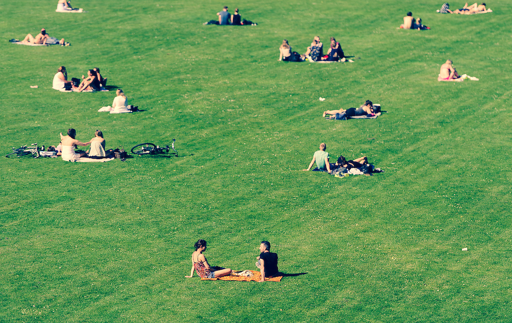 The parks and open areas in and around Copenhagen offer lots of space for people to chill out and relax throughout the day.<br />