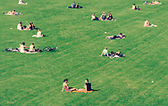 The parks and open areas in and around Copenhagen offer lots of space for people to chill out and relax throughout the day.<br /> <br /> Pictured here are families, friends and individuals enjoying the sun in Frederiksberg Have