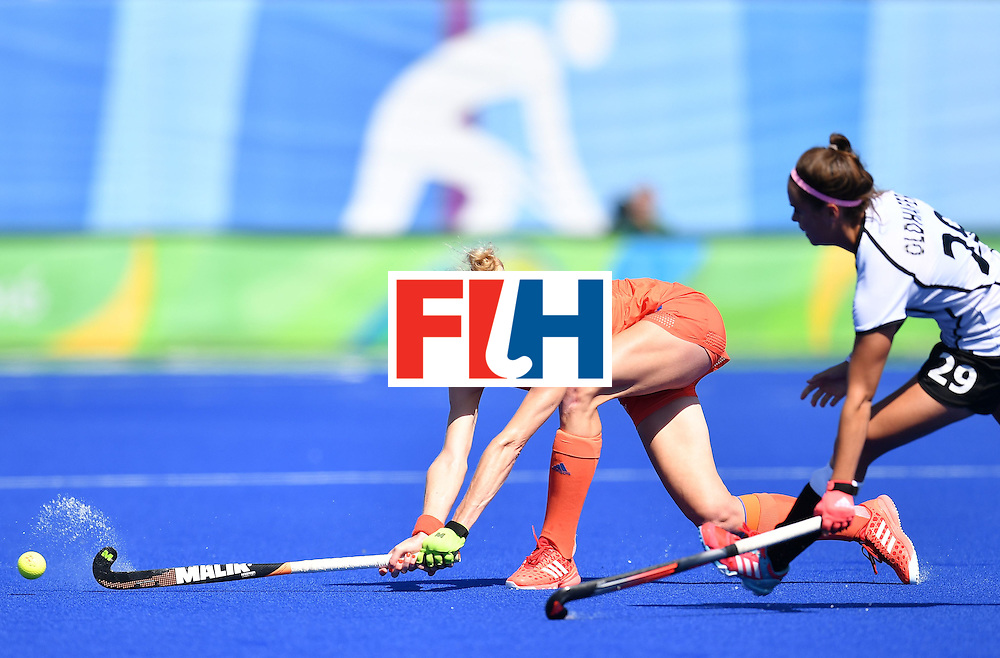 Netherlands' Willemijn Bos (L) and Germany's Pia-Sophie Oldhafer vie during the women's field hockey Netherlands vs Germany match of the Rio 2016 Olympics Games at the Olympic Hockey Centre in Rio de Janeiro on August, 13 2016. / AFP / MANAN VATSYAYANA        (Photo credit should read MANAN VATSYAYANA/AFP/Getty Images)
