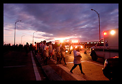29th August, 2005. Hurricane Katrina hits New Orleans, Louisiana. Refugees from the flooding board vehicles for the Superdome.
