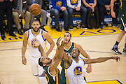Golden State Warriors forward Andre Iguodala (9) and Utah Jazz center Rudy Gobert (27) battle for a rebound in the second quarter at Oracle Arena in Oakland, Calif., on December 20, 2016. (Stan Olszewski/Special to S.F. Examiner)