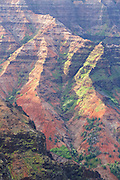 Evening light on the red ridges of Waimea Canyon, in Waimea Canyon State Park, Kauai, Hawaii.