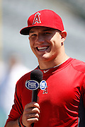 ANAHEIM, CA - JULY 21:  Mike Trout #27 of the Los Angeles Angels of Anaheim laughs as he does a pre-game interview before the game against the Texas Rangers on Saturday, July 21, 2012 at Angel Stadium in Anaheim, California. The Rangers won the game 9-2. (Photo by Paul Spinelli/MLB Photos via Getty Images) *** Local Caption *** Mike Trout