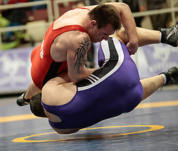 London, Ontario ---2013-03-02--- Tom Macrae of The University Of New Brunswick takes on Cory Palmer of Western in the men's 130 KG 5th/6th match at the 2012 CIS Wrestling Championships in London, Ontario, March 02, 2013. .GEOFF ROBINS/Mundo Sport Images