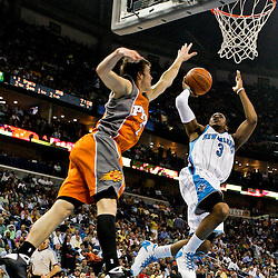 08 April 2009: New Orleans Hornets guard Chris Paul (3) shoots over Phoenix Suns guard Goran Dragic (2) during a NBA game between the New Orleans Hornets and the Phoenix Suns at the New Orleans Arena in New Orleans, Louisiana.