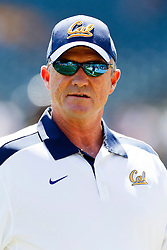 September 17, 2011; San Francisco, CA, USA;  California Golden Bears head coach Jeff Tedford watches his team warm up before the game against the Presbyterian Blue Hose at AT&T Park.