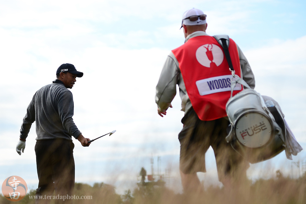 July 20, 2012; St. Annes, ENGLAND; Tiger Woods hands his club to caddy Joe LaCava (not pictured) after a fairway shot on the 11th hole during the second round of the 2012 British Open Championship at Royal Lytham & St. Annes Golf Club.