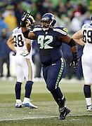Seattle Seahawks defensive tackle Brandon Mebane (92) points as he indicates a turnover overturned by officials during the 2015 NFL week 16 regular season football game against the St. Louis Rams on Sunday, Dec. 27, 2015 in Seattle. The Rams won the game 23-17. (©Paul Anthony Spinelli)