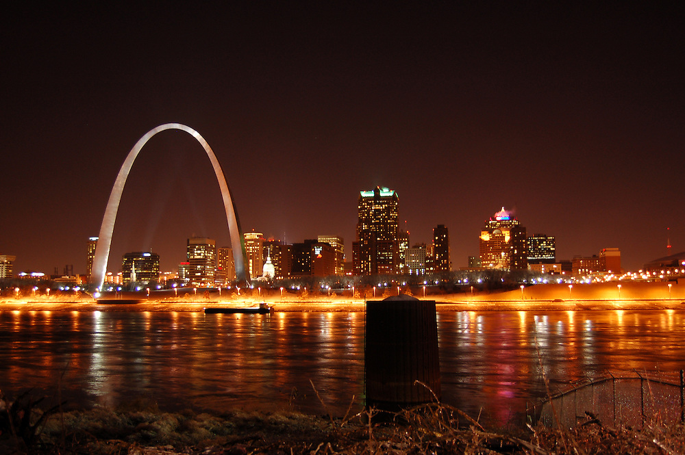An icy Mississippi river. St. Louis, Missouri (USA). A nightshot of the city of St. Louis taken from the east side of the Mississippi river looking west at the cityscape and the arch, which they call the gateway to the west..