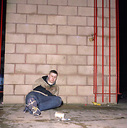 A very drunk ill looking teenage boy sprawled on the pavement, Cardiff, Wales 2000