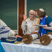 CHEVY CHASE, MD -MAY14: Charlotte Markowitz, 85, after she reads from the Torah during her Bat-Mitzvah ceremony at the Five Star Residences in Chevy Chase, Maryland, May 14, 2016, as Dan Cohen and Cantor Susan Berkson look on. The women who were unable to have a Bat-Mitzvah ceremony at the traditional age of 13 because they were girls, are now finally able to celebrate this traditional Jewish coming of age ceremony. (Photo by Evelyn Hockstein/For The Washington Post)