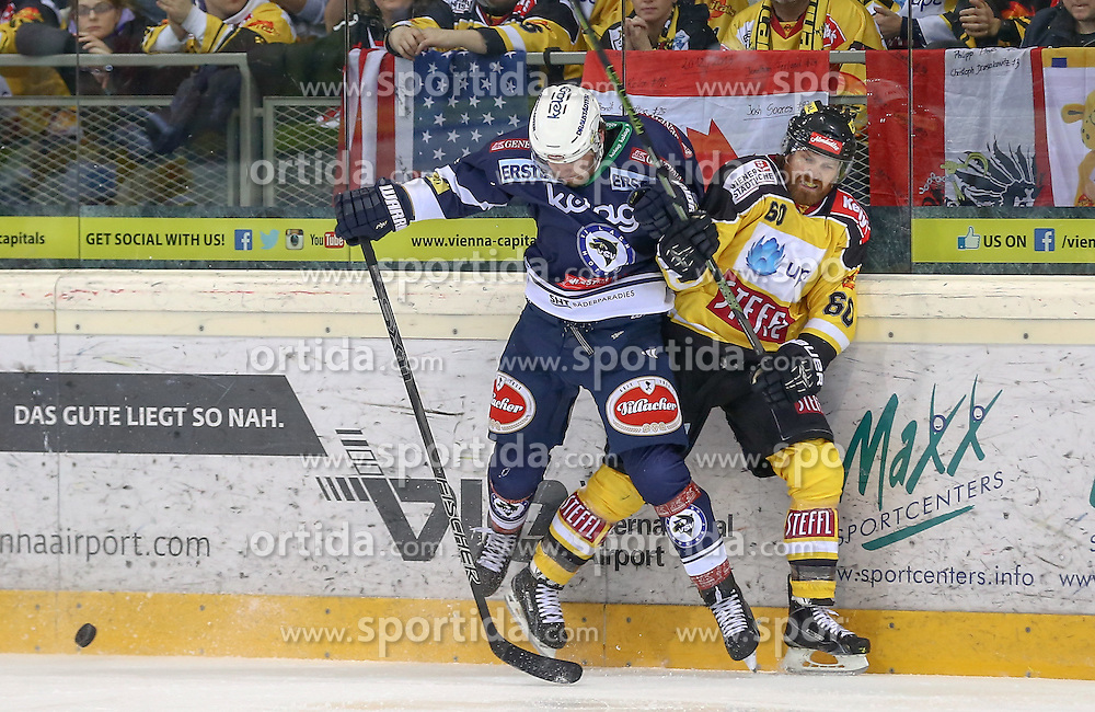 28.12.2015, Albert Schultz Halle, Wien, AUT, EBEL, UPC Vienna Capitals vs EC VSV, 36. Runde, im Bild Ruslan Lenarovich Gelfanov (EC VSV) und Troy Milan (Vienna Capitals) // during the Erste Bank Icehockey League 36th round match between UPC Vienna Capitals and EC VSV at the Albert Schultz Halle in Vienna, Austria on 2015/12/28. EXPA Pictures © 2015, PhotoCredit: EXPA/ Alexander Forst