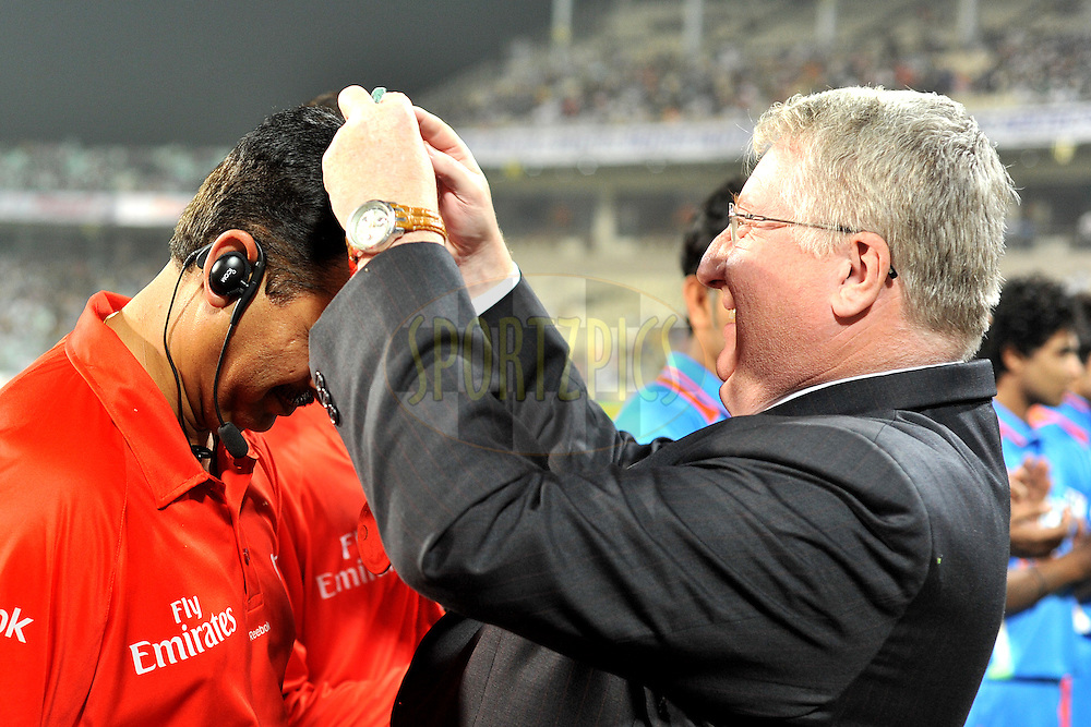 David Collier CEO ECB presents medals to a match refree during the T20 International match between India and England held at the Eden Gardens Stadium, Kolkata on the 29th October 2011..Photo by Pal Pillai/BCCI/SPORTZPICS