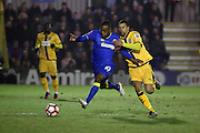 AFC Wimbledon striker Dominic Poleon (10) battles for possesion with Sutton United midfielder Craig Eastmond (15) during the The FA Cup third round replay match between AFC Wimbledon and Sutton United at the Cherry Red Records Stadium, Kingston, England on 17 January 2017. Photo by Matthew Redman.