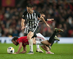 Juan Mata of Manchester United (C) is fouled by Bojan Ostojic of Partizan - Mandatory by-line: Jack Phillips/JMP - 07/11/2019 - FOOTBALL - Old Trafford - Manchester, England - Manchester United v Partizan - UEFA Europa League