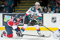 KELOWNA, CANADA - MARCH 23: Marek Tvrdon #17 of the Kelowna Rockets looks for the shot while being stick checked by Parker Wotherspoon #37 of the Tri-City Americans on March 23, 2014 at Prospera Place in Kelowna, British Columbia, Canada.   (Photo by Marissa Baecker/Shoot the Breeze)  *** Local Caption *** Marek Tvrdon; Parker Wotherspoon;