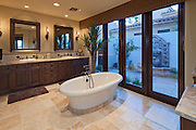 Bathtub in spacious bathroom of luxury villa