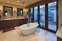 Bathtub in spacious bathroom of luxury villa