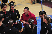 February 7, 2010; Stanford, CA, USA; Stanford Cardinal assistant coach Chris Swircek (center) instructs his gymnasts before performing on the bars during a quad-meet against the Washington Huskies, the Sacramento State Hornets, and the San Jose State Spartans at Burnham Pavilion. Stanford scored 196.650, Washington 194.075, Sacramento State 193.225, and San Jose State 192.800. Mandatory Credit: Kyle Terada-Terada Photo