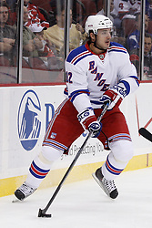 Oct 5, 2009; Newark, NJ, USA; New York Rangers right wing Ales Kotalik (12) skates with the puck during the first period at the Prudential Center.