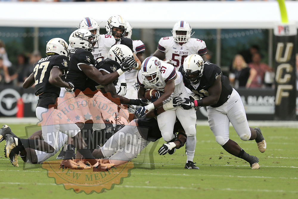 ORLANDO, FL - SEPTEMBER 08:  Farrika Grier #37 of the South Carolina State Bulldogs drags the pile during a football game against the UCF Knights at Spectrum Stadium on September 8, 2018 in Orlando, Florida. (Photo by Alex Menendez/Getty Images) *** Local Caption *** Farrika Grier