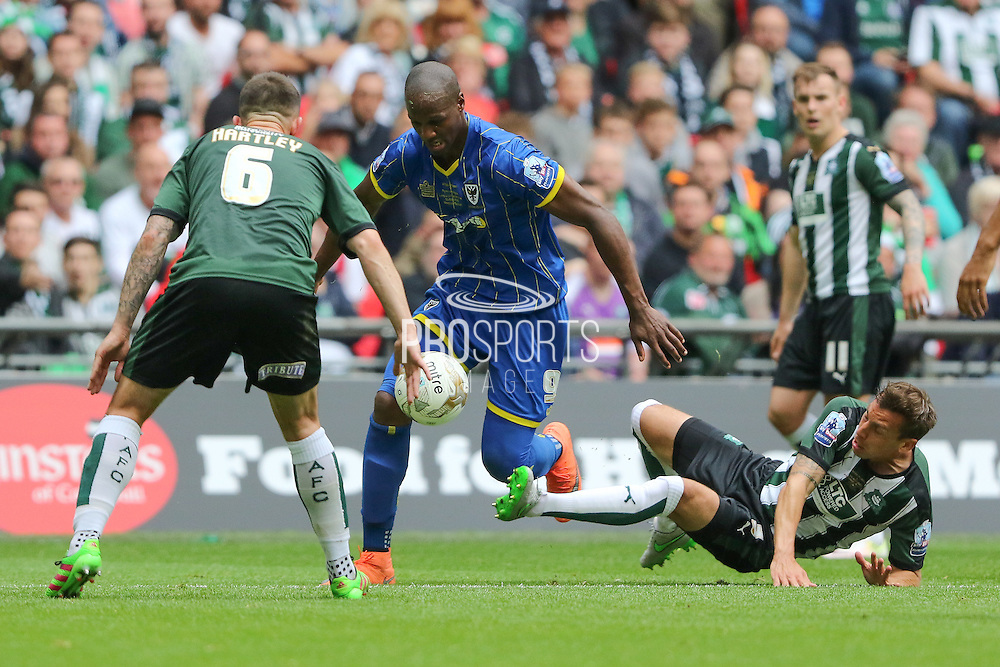 Plymouth Argyle defender Gary Sawyer (3) makes a challenge on Tom Elliott forward for AFC Wimbledon (9) during the Sky Bet League 2 play off final match between AFC Wimbledon and Plymouth Argyle at Wembley Stadium, London, England on 30 May 2016. Photo by Stuart Butcher.