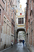 A bridge over a cobbled street near Burg in Bruges