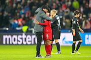 Liverpool Head Coach Jürgen Klopp congratulates Liverpool midfielder Georginio Wijnaldum (5) at full time during the Champions League match between FC Red Bull Salzburg and Liverpool at the Red Bull Arena, Salzburg, Austria on 10 December 2019.