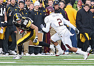 November 21, 2009: Iowa wide receiver Trey Stross (86) tries to get around Minnesota cornerback Ryan Collado (2) during the first half of the Iowa Hawkeyes 12-0 win over the Minnesota Golden Gophers at Kinnick Stadium in Iowa City, Iowa on November 21, 2009.