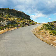 A road leading uphill in the middle of the Tabernas desert (Almeria, Andalucia, Spain).<br />