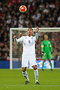 England's Chris Smalling heads the ball during the UEFA European 2016 Qualifier match between England and Estonia at Wembley Stadium, London, England on 9 October 2015. Photo by Shane Healey.