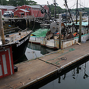7/3/11 -- Rt 129 , Maine.Wharf. end of day. pretty quiet.  A stretch of the road not often traveled. Spanning communities, classes and styles ~ of farmers and fishermen, retired and plugging, the elite and working waterfront. (This area has huge potential for great photojournalism).  Photo by Roger S. Duncan.