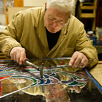 Venice Stained glass artist at work in his worksop in Venice..HOW TO BUY THIS PICTURE: please contact us via e-mail at sales@xianpix.com or call our offices in Milan at (+39) 02 400 47313 or London   +44 (0)207 1939846 for prices and terms of copyright..